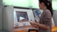 Woman at ticket kiosk