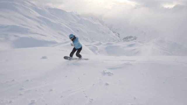 SLO MO Woman backcountry snowboarding