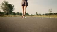 Woman balancing over street