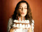 Woman Blowing Birthday Cake candles (PAL Video)
