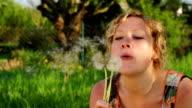 SLOW MOTION: Woman Blowing Dandelion