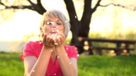 HD SUPER SLOW MO: Woman Blowing Flower Petals
