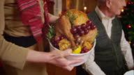 SLO MO woman bringing Christmas turkey to the table