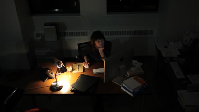 woman business executive working late at the office