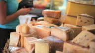MS Woman buying cheese at market stall