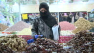 MS Woman buying dates in  market / Taroudant, Unspecified, Morocco