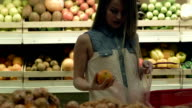Woman buying groceries in supermarket