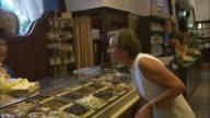 MS Woman buying sweets at Dallmayr, luxury delicatessen, Munich, Bavaria, Germany