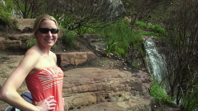 MS Woman by waterfall on Table Mountain / Cape Town, South Africa