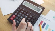 Woman calculating.
