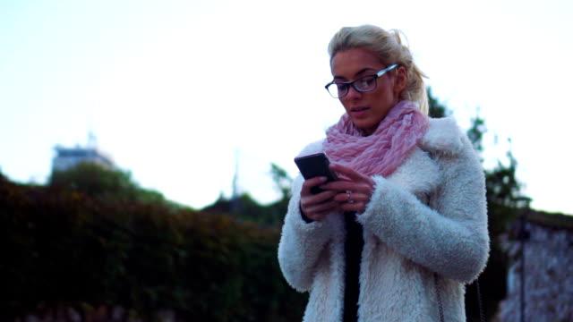 Woman checking texts