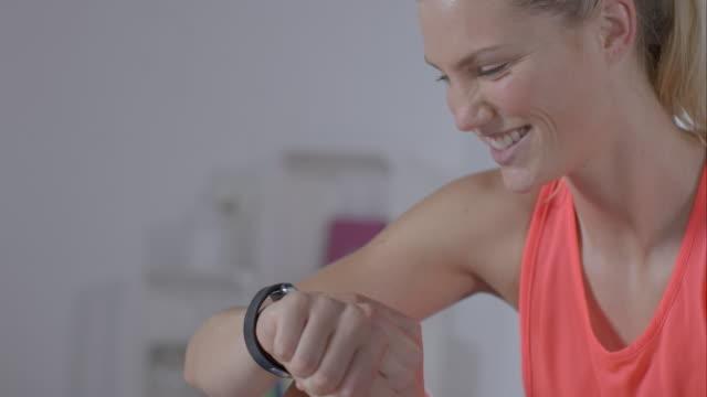 Woman cheking her smartwatch