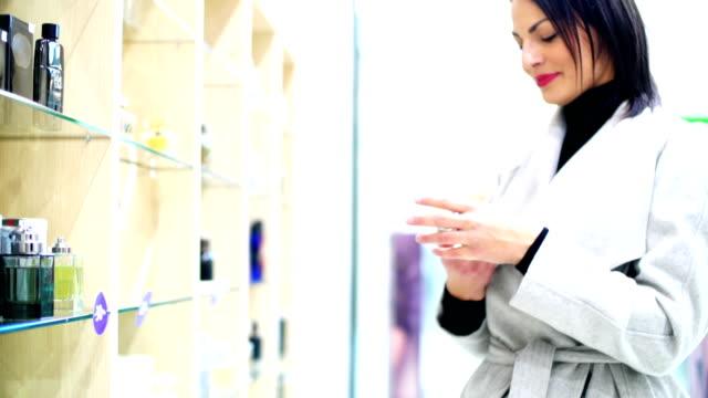 Woman choosing a perfume.