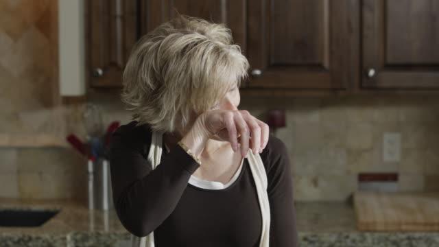 MS TD Woman chopping onions and crying / Orem, Utah, USA