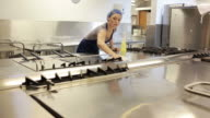 Woman cleaning a counter of a kitchen
