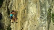 WS Woman climbing rock face/ Krabi, Thailand