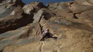 WS DS Woman climbing rock / Moab, Utah, USA