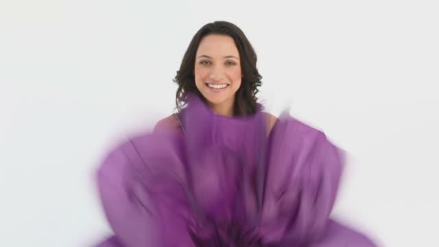 Woman closes an umbrella
