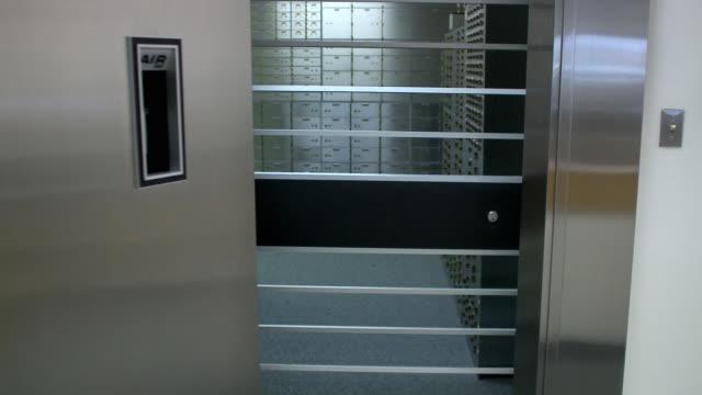 MS Woman closing bank vault door, Bethlehem, Pennsylvania, USA