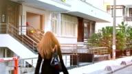 HD: Woman coming home