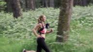SLO MO DS Woman competing in a trail run marathon