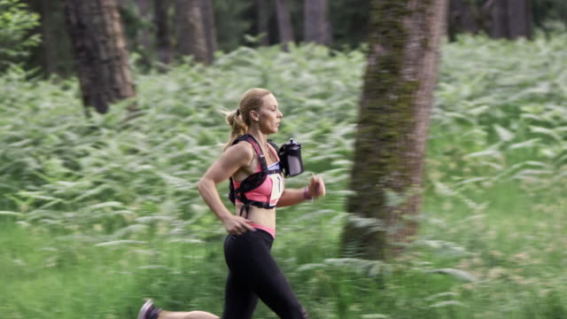 SLO MO DS Woman competing in a trail run marathon