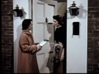 MS, Woman conducting survey with woman standing in doorway