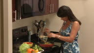 MS Woman cooking fresh vegetables in kitchen, Austin, Texas, USA