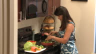 MS ZI Woman cooking fresh vegetables in kitchen, Austin, Texas, USA