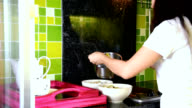 Woman cooking in modern kitchen / people healthy lifestyle concept