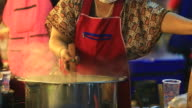 Woman cooking noodle
