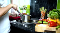 Woman cooking with kitchenware, variety vegetable in kitchen / activity & healthy lifestyle conceptual