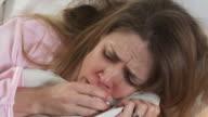 CU Woman coughing laying in bed, Phoenix, Arizona, USA