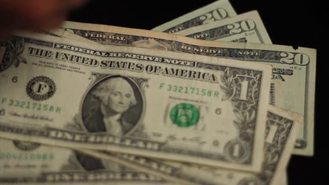 A Woman Counts Cash