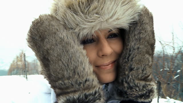 HD STEADYCAM SLOW-MOTION: Woman Covering Her Face In Snow