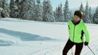 TS SLO MO woman cross country skiing in nature