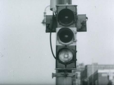 A woman crosses Kensington High Street 1951