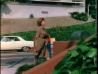1967 PAN TU Woman crossing street and entering alcohol treatment center, Los Angeles, California, USA, AUDIO