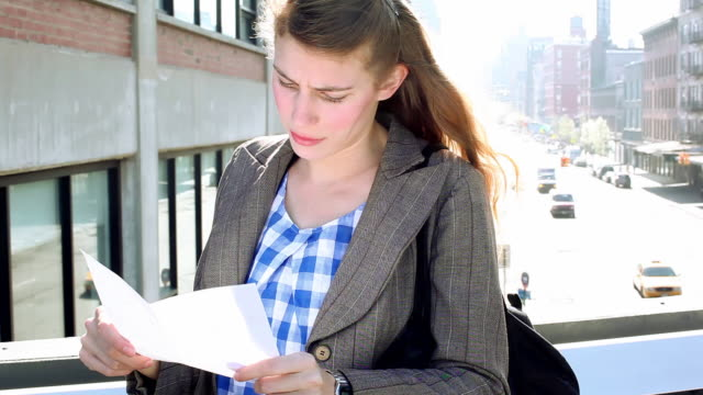 MS Woman crying after reading lettre on High Line / New York City, New York, United States
