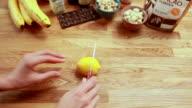 POV woman cutting a lemon in half