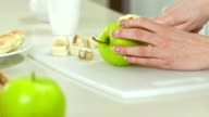 Woman Cutting An Apple