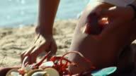 ECU, TD, TU, Woman cutting lobster tail on beach, North Truro, Massachusetts, USA