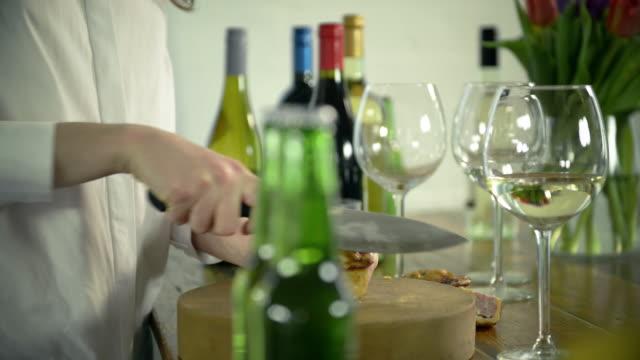 Woman cutting savory pie