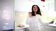 Woman dancing at home and singing