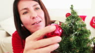 Woman decorating her Christmas tree