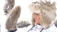 HD SUPER SLOW-MO: Woman Defending From Snowballs