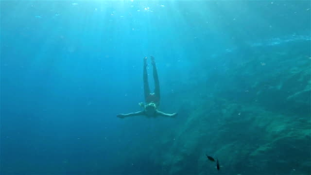 Woman diving undersea