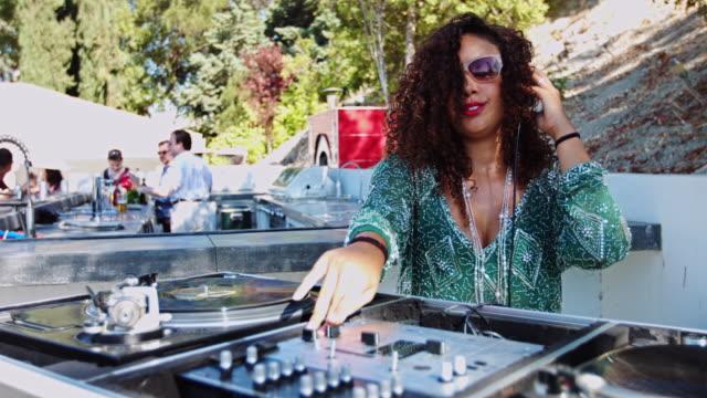 Woman DJing at Pool Party