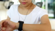 Woman doing exercises with smartwatch