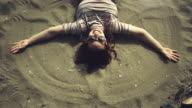 Woman doing the sand angel